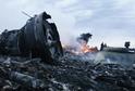 Trosky zříceného letounu letu MH17.