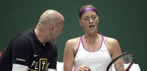 Petra Kvitova of Czech Republic, right, speaks to her coach David Kotyza between sets as she plays against Agnieszka Radwanska of Poland during the singles final at the WTA tennis finals in Singapore Sunday, Nov. 1, 2015.