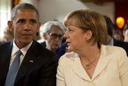 Obama s Merkelovou: Rusové se v Sýrii chovají barbarsky