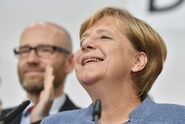 Merkelová utrpěla ztráty, profitovala z toho kontroverzní AfD