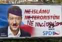 Pomalovaný předvolební billboard se sloganem Ne islámu, ne teroristům a předsedou hnutí Svoboda a přímá demokracie (SPD) Tomiem Okamurou v ulici Jana Želivského v Praze.