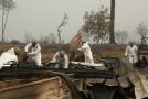 Národní garda hledá lidské pozůstatky po požáru.