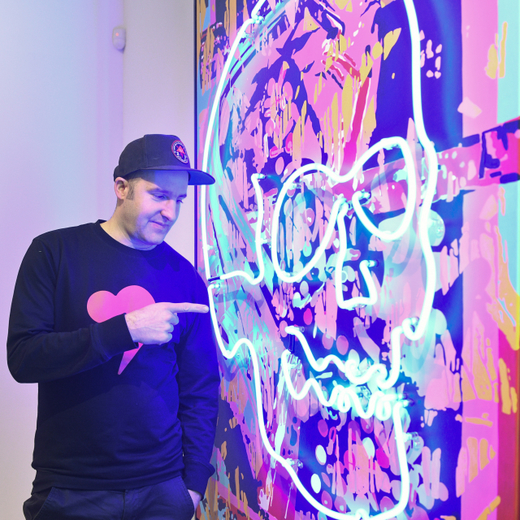 The artist and graphic designer Michal Shpapa with his work.