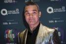 Zpěvák Robbie Williams.