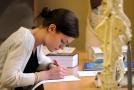 Studentka při maturitní zkoušce (ilustrační foto).