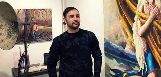 Výtvarník Lyuben Petrov na své výstavě v kanadském Montrealu.