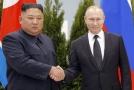 Ruský prezident Vladimir Putin a severokorejský diktátor  Kim Čong-un.