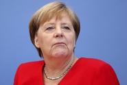 Merkelová chce v řešení migrace podporu celé EU, sankce odmítá