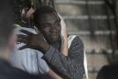 Jeden z migrantů z humanitární lodi Open Arms.